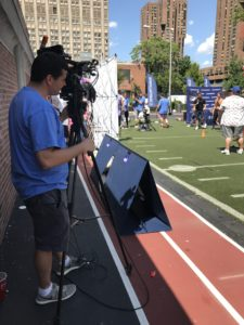 video production crew filming a sports event